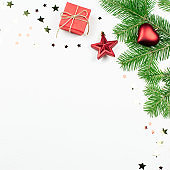 Christmas tree with red decorations and giftbox border, copy space