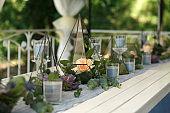 Florarium with fresh succulent and rose flowers festive table decoration. Event fresh flowers decoration. Florist workflow. Wedding ceremony  design
