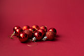 Red Christmas tree decorative toy balls on red celebratory Christmas background. New Year's holidays. Christmas holidays