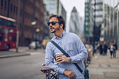 City man with bicycle