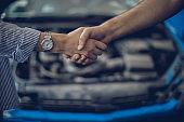 Mechanic and lady handshake