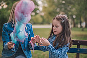 Mother and kid eating cotton candy