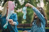 Mon and daughter eating cotton candy