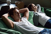 Young couple sitting and couch and relaxing