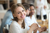 Portrait of smiling female employee posing at workplace