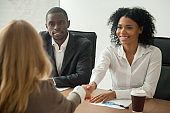 African american hr team welcoming female applicant at job interview