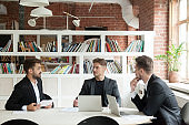 Startupper discussing new project convincing investors at meeting in office