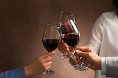 People have a toast with red wine