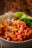 Kimchi-jjigae is a Korean dish, made with kimchi and other ingredients