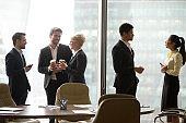 Multiracial, business people talking in break and drink coffee