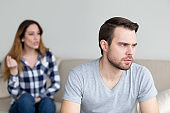 Annoyed husband tired of wife lecturing and arguing