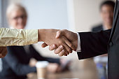Close up of businessman handshake intern greeting with promotion