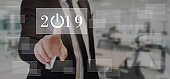 businessman touching power button inside 2019