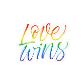 Love wins lettering with rainbow. LGBT rights symbol.