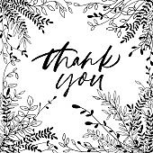 Thank you phrase with hand drawn plant elements.