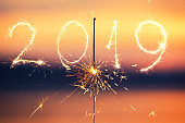2019 written with Sparkle firework on sunset background, happy new year