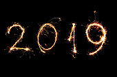 2019 written with Sparkle firework on black background, happy new year
