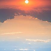 Sunset with sun on blue dramatic sky
