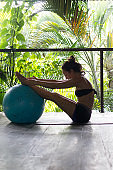 Pilates Instructor Woman in Balinese peaceful retreat