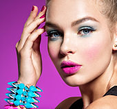 Fashion portrait of a beautiful woman with bright makeup.