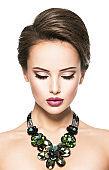 beautiful woman with fashionable green jewelry