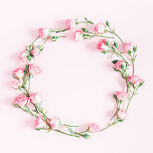 Wreath made of pink rose flowers. Flat lay, top view