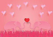 Valentines day concept with elephant and heart shape on pink vector background, Paper art style