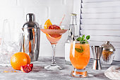 Paloma cocktail with fresh grapefruit, orange and mint