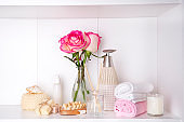Spa bath cosmetic and flower rose, isolated on white