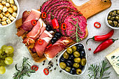 Mediterranean food selection with antipasti, italian diet with spicy cold dishes on table