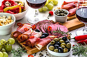 Traditional spanish tapas bar or wine snack set on table, food selection, mediterranean diet