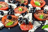 Vegetarian salad with tomatoes and feta, greek cuisine, mediterranean food