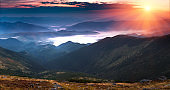 Panoramic view of beautiful landscape in the mountains at sunrise.