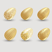 Golden easter eggs with shadow on gray background