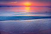 The sand shore and the ocean. Sunset. Thailand