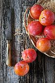 Red plums in wicker basket