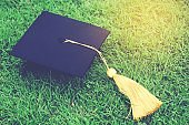 shot of graduation hats on the grass, concept during commencement success graduates of the university,Concept education congratulation. Graduation Ceremony ,Congratulated the graduates in University.