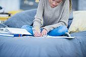 Studious teen girl doing homework