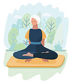 Elderly woman practicing yoga in park
