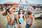 Girls eating cotton candy at the county fair