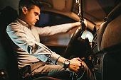 Tough elegant man in a car