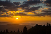 Germany, Black forest sunrise on mountain top with fog in autumn