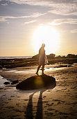 Girl in white Dress at Sunset in Bali