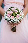 Wedding bouquet of flowers in brides' hands