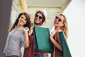Beautiful woman with shopping bags in the city-sale, shopping, tourism and happy people concept