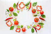 Colorful salad ingredients pattern made of tomatoes, pepper, chili, garlic, cucumber slices and  basil on white background. Cooking concept. Top view. Flat lay. Copy space