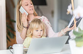 Single mom entrepreneur balancing business and baby, working from home