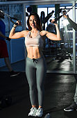 Young attractive girl in the gym ready to start practicing