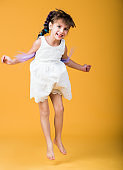 Portrait of young little girl jumping