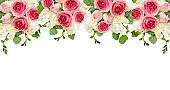 Eucalyptus leaves, freesia and pink rose flowers in a top border arrangement